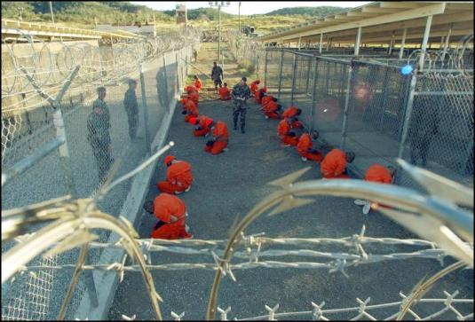 Guantanamo_captives_wait_during_processing_on_January_11th,_2002